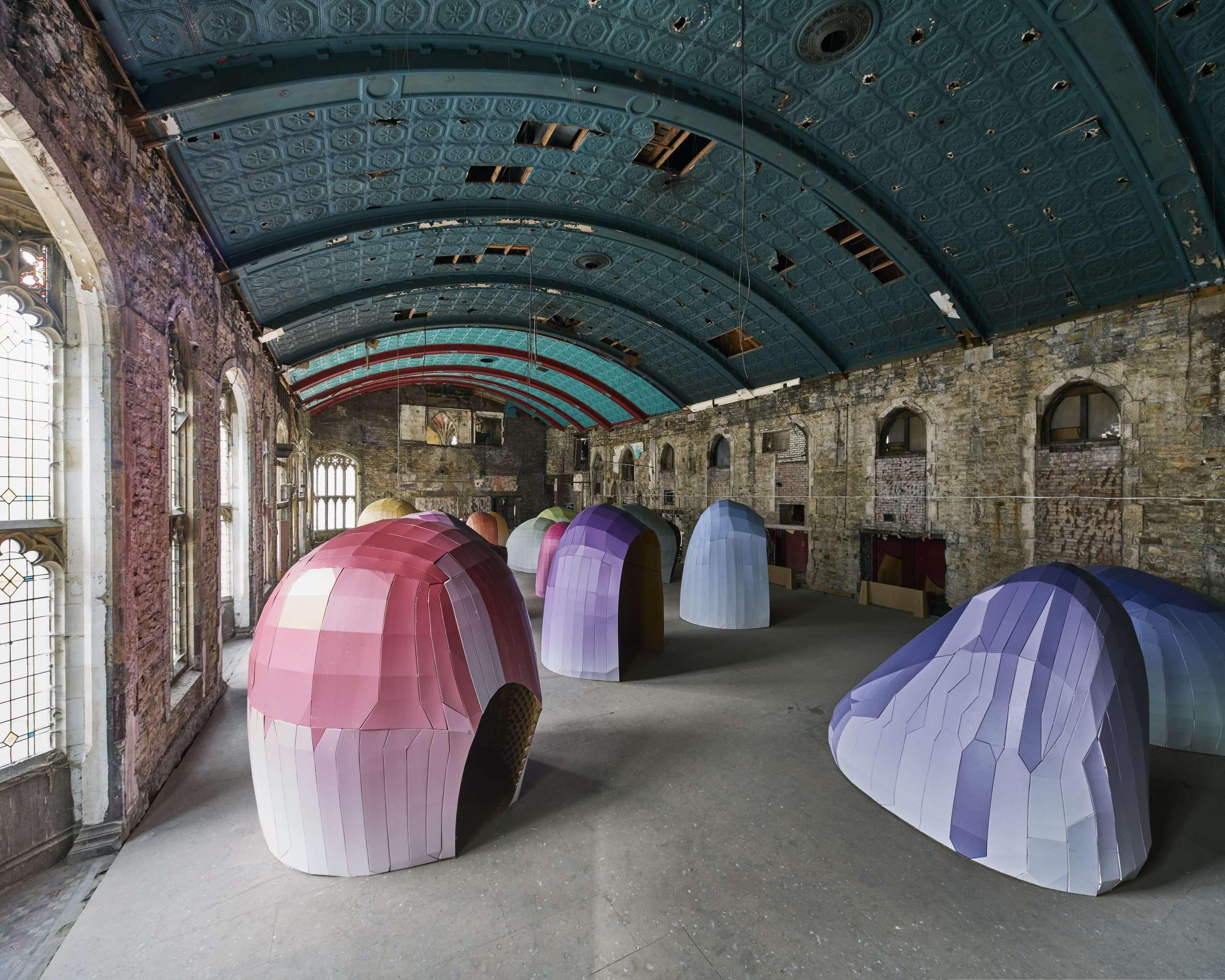 Public art installation using cardboard coloured pods by design studio Lazerian