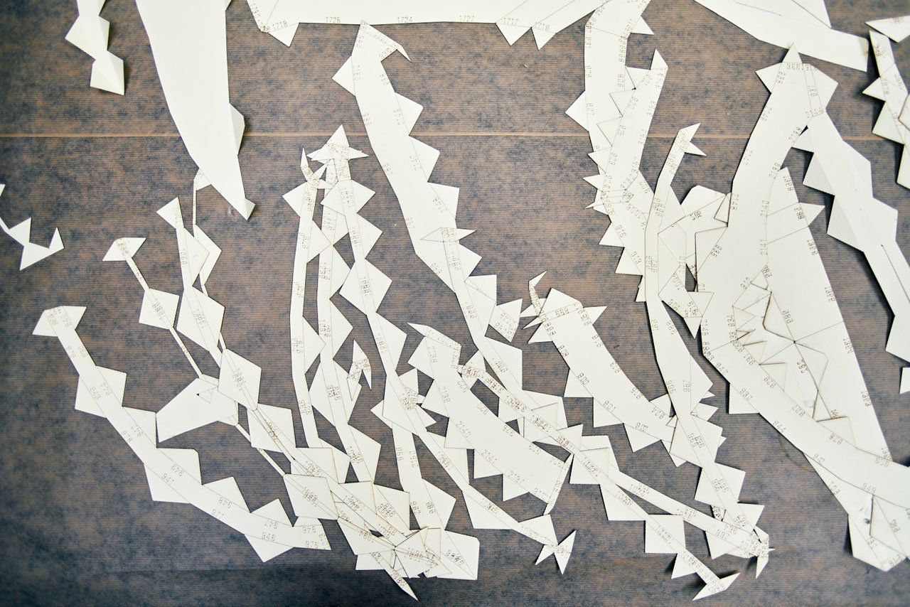 A working shot of paper pieces that will be used for a large scale paper sculpture. From design studio Lazerian.