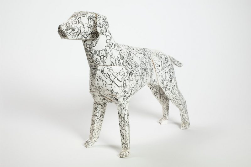 White paper dog model with a black line pattern all around it. Part of an design exhibition by studio Lazerian. Design by Andy Singleton.