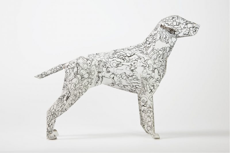 Side view of a black and white paper dog sculpture by design studio Lazerian. Pattern by Andy Singleton