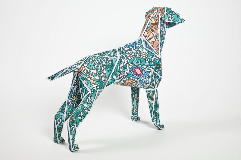 Left hand view of a paper dog model sculpture. It is green covered in mechanical, robot style doddles all over it. Part of a paper dog exhibition by Lazerian