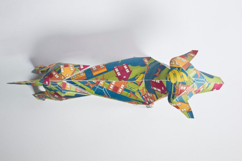 Over head view of a paper dog sculpture. Part of a design exhibition by Lazerian