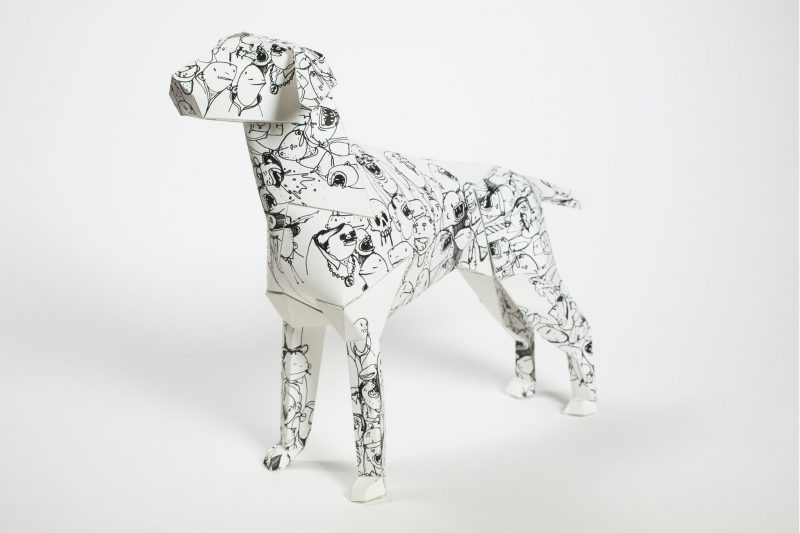 Left hand view of a paper dog model sculpture