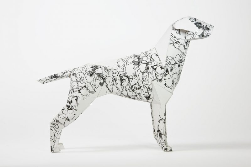 Side view of a black and white patterned paper dog model. Part of a exhibition from design studio Lazerian