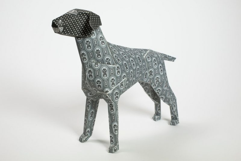 Left hand view of a grey patterned paper dog sculpture model Part of an international design exhibition from studio Lazerian