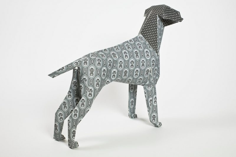 Left hand view of a grey patterned paper dog sculpture by international artist Christian Montenegro. Part of a exhibition by design studio Lazerian