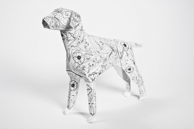 A model dog sculpture made from paper with a repeat flower pattern. DEsigned by Daren Newman as part of a art exhibition by design studio Lazerian
