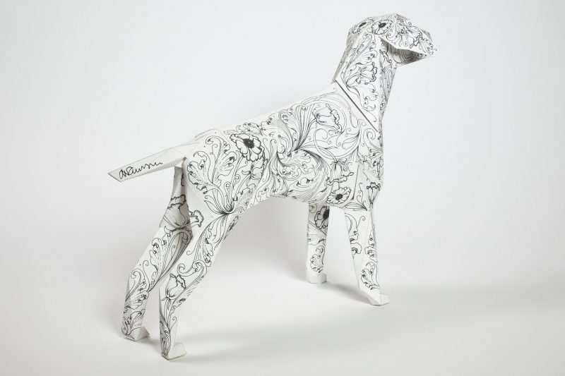 Paper dog model with a repeat flower pattern in black and white. designed by Daren Newman for a exhibition by design leaders Lazerian