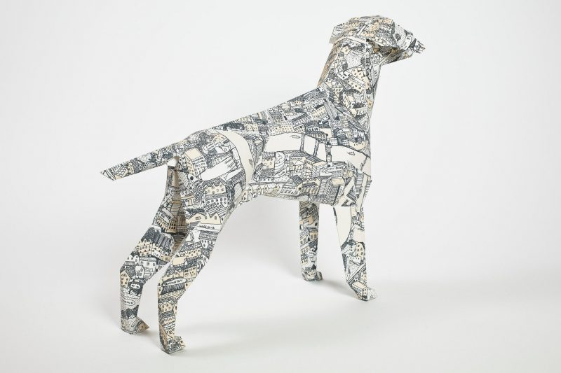 Paper dog with a design of a street mat on his whole body. The design is by David Ryan Robinson and is part of an exhibition by design leaders Lazerian