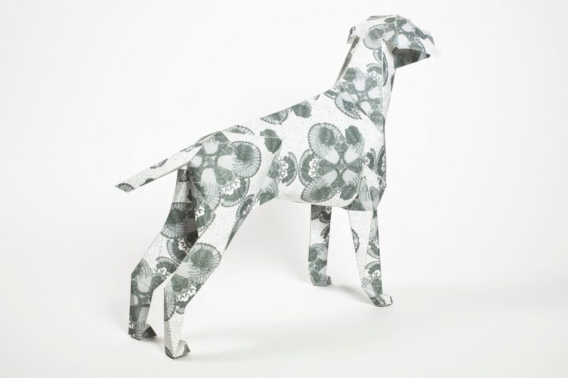 A paper dog sculpture which is part of an international design exhibition by design leaders Lazerian. The dog were given to artits and designers to create their own pattern or design on them. This one has a simple lace effect which has been handdrawn by the artist- Deborah Ballinger