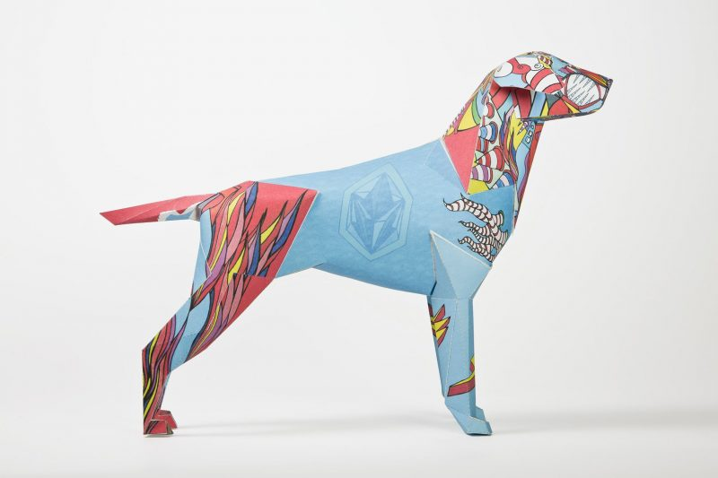 A paper dog model in 3D form designed by Goo For Brothers. Part of an exhibition whereas designers and artists were invited to put their own signature styles on the paper dogs which are the mascot of designer Lazerian. This effort from Goo For Brothers is a colourful design with a bright blue centre with a fire like style on the head and hind legs. They are all in the colour of blue, yellows and reds.