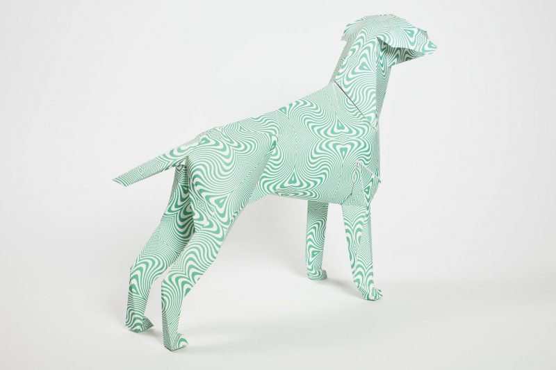 Back view of a psychedelic green style pattern that is on the form of a 3D paper dog sculpture. the design is from Hawaii design and is for an exhibition by Lazerian.