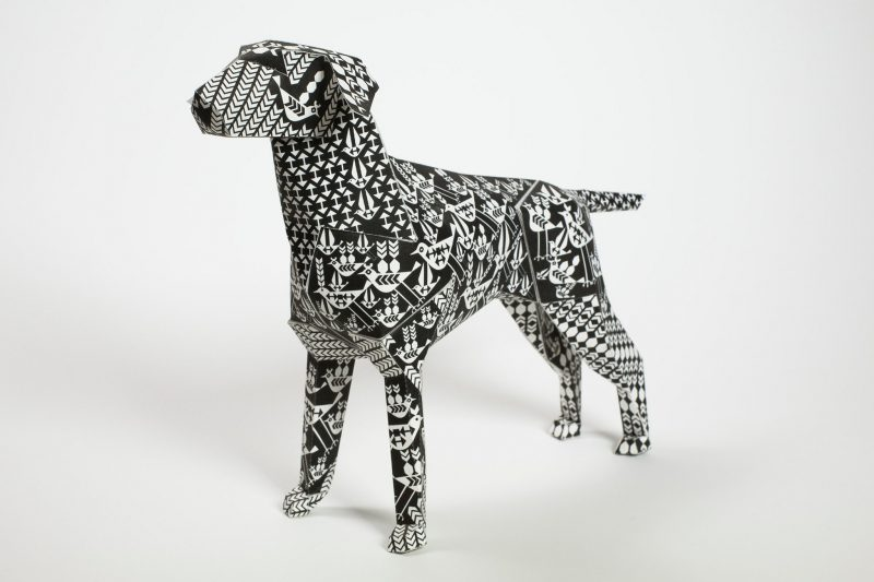 Gerald the lazerian paper dog covered in a black and white pattern.