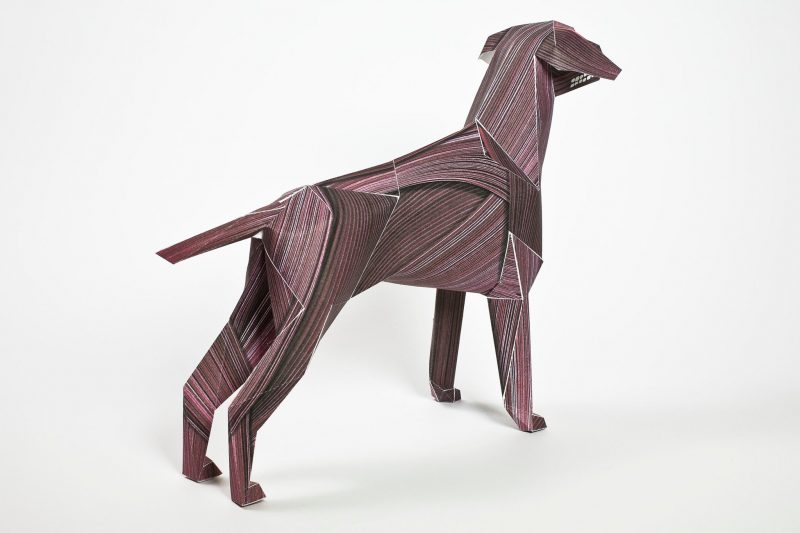 The back view of a dark red paper dog model that is designed to look like a wood veneer style effect