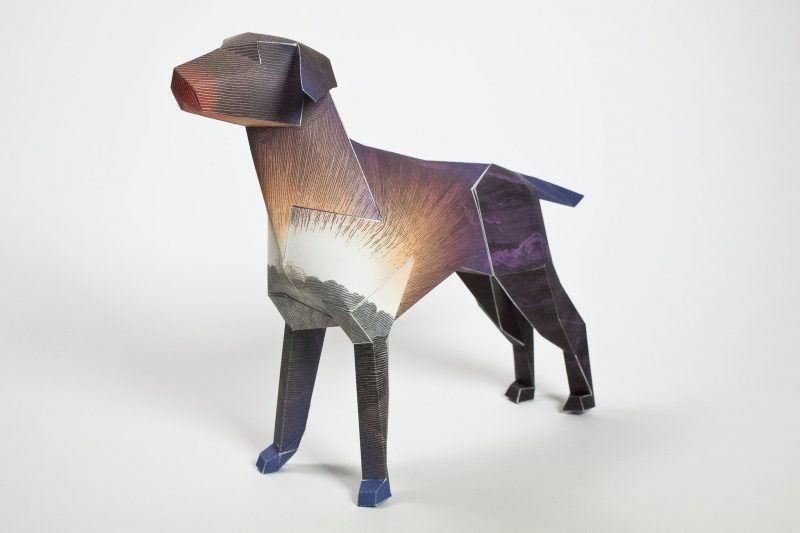 A brown and purple paper dog design as part of an art exhibition