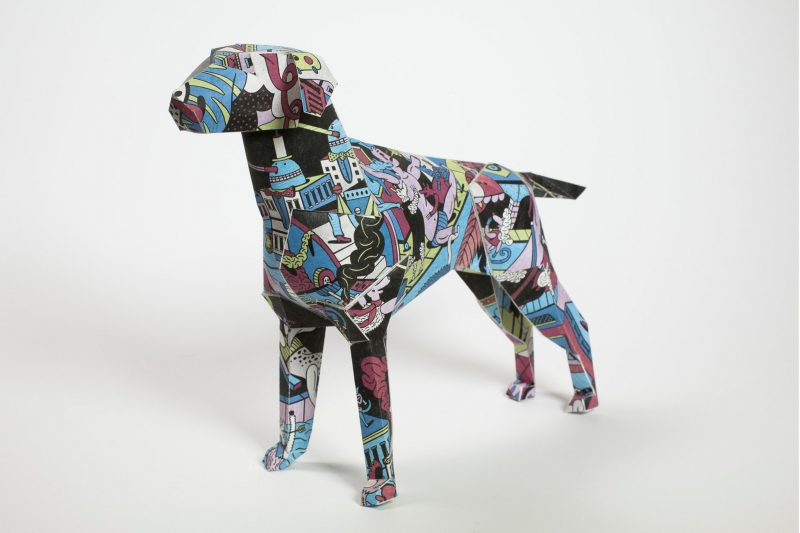 Paper dog model with a comic style pattern
