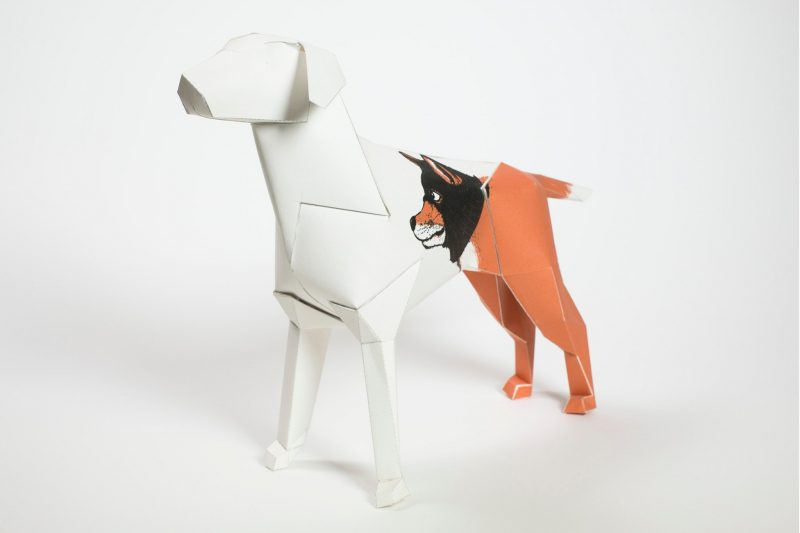 A 3D paper dog model with a picture of a wolf on its body.