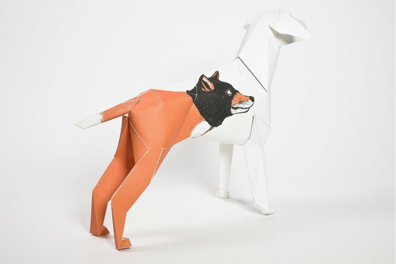 A paper dog model that is 3D and has a wolf face on the dogs body
