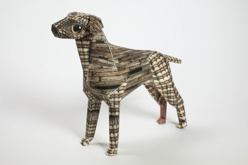 A 3D model of a paper dog with a wood grain style pattern