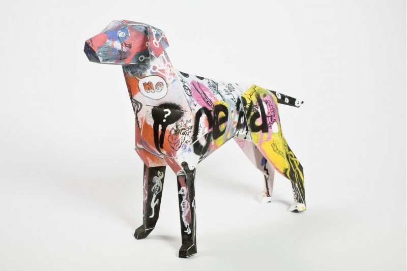 Paper dog model in 3D form with a graffiti style design on its body