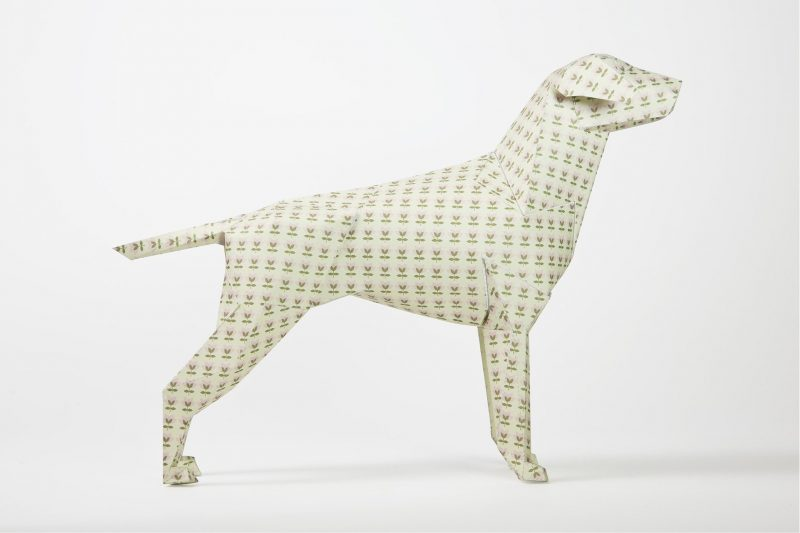 Side view of a 3D paper dog model with a pattern all over it. This is minituare tulip style flowers in a khaki green colour.