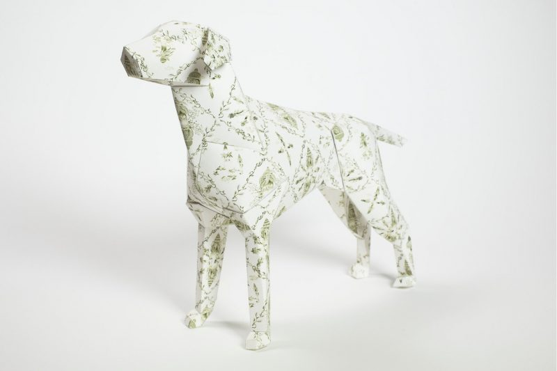 Paper dog model with a criss cross pattern