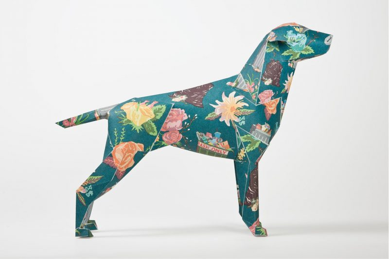 Paper dog model, Side view. Pattern on its coat is a green background with pastel coloured flowers
