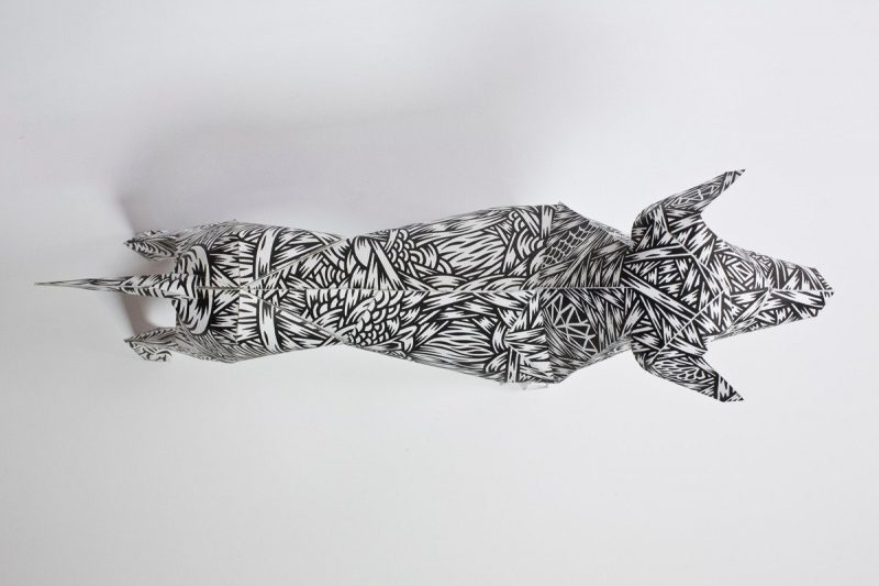 A overhead view of a paper dog model with a monochrome pattern