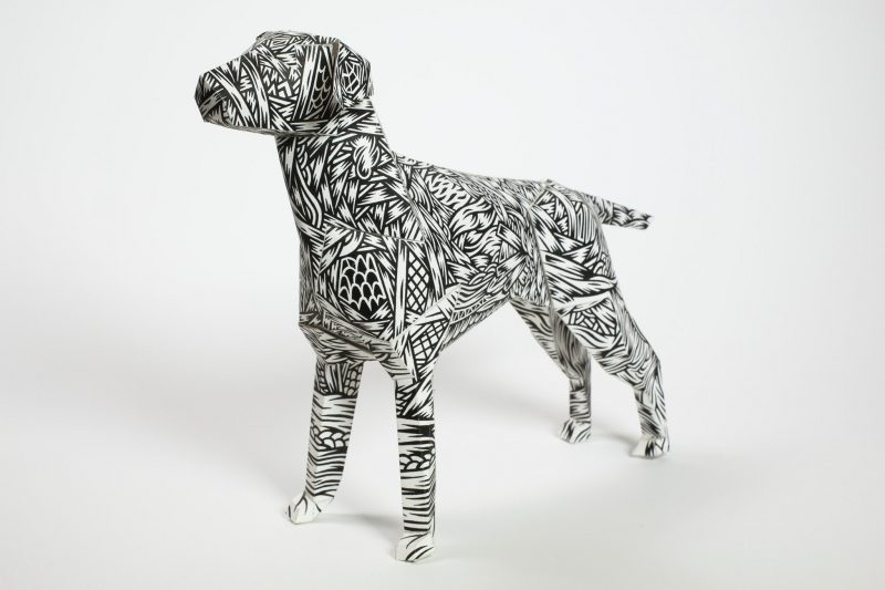 Paper dog model made by Lazerian studio. With a black and white structured pattern