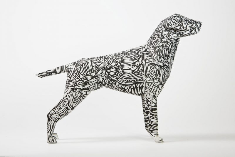 Paper dog model with a monochrome structured pattern