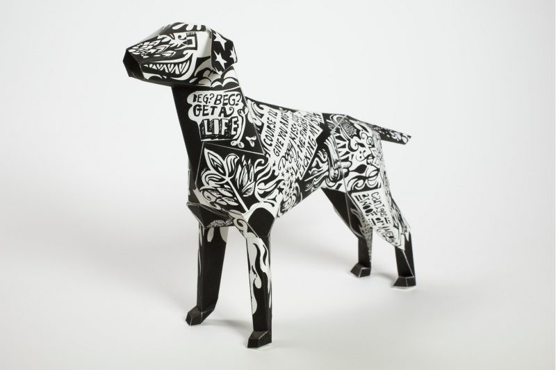 Black and white paper dog model known as Gerald and mascot of design studio Lazerian
