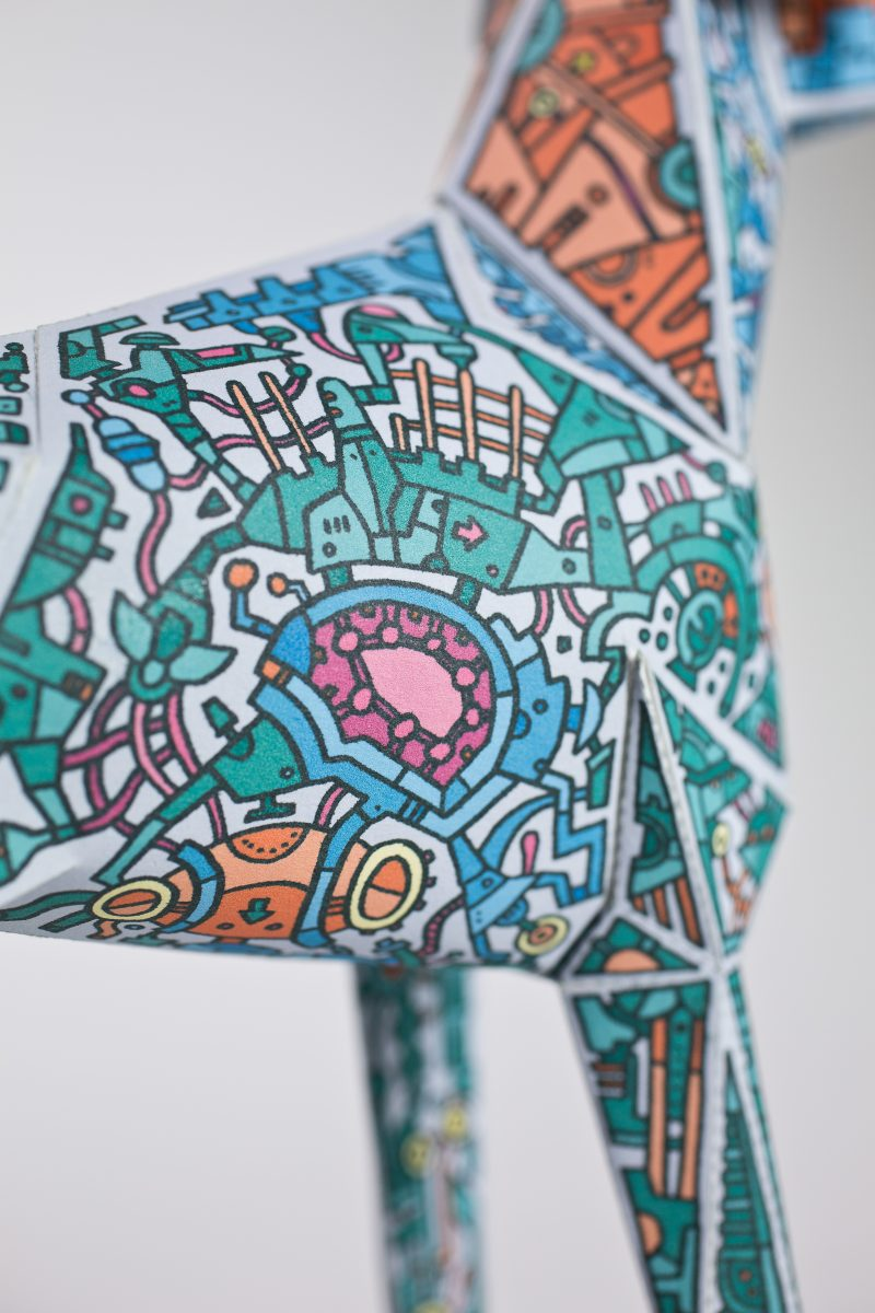 Close up of some doodles of mechanical styles drawings on a paper dog model. MAde for the Gerald exhibition where artists drawn there own designs on design studios mascot Gerald the Lazerian dog