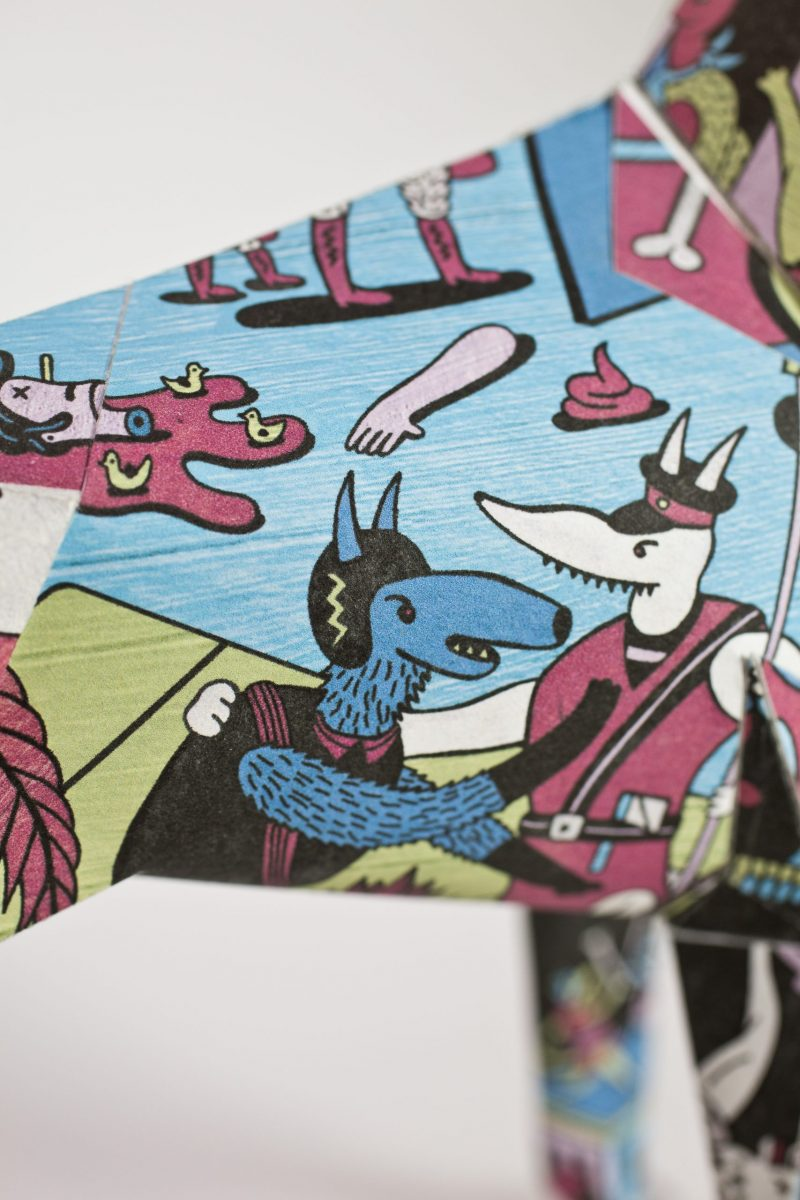 Close up view of a comic style pattern with animals as people. Very colourful .