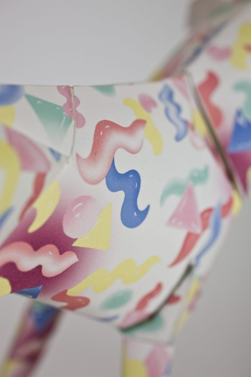 Close up of a pattern which consists of pink, blue and yellow squiggles