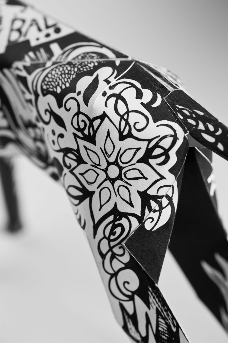 Paper dog model by Lazerian. DEsign is a black and white coat