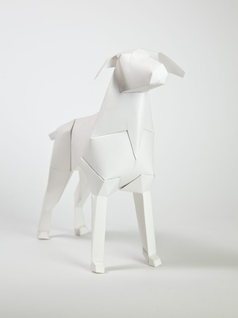 A paper dog model in 3D sculptural form with a plain white coat. Created and designed by design studio Lazerian who curated a exhibition and project in honour of their mascot and logo gerald the paper dog.