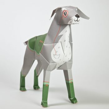 A 3D paper dog model with a design on it that makes it seem to be a old style general from a army with a eye monocle and medals on its coat