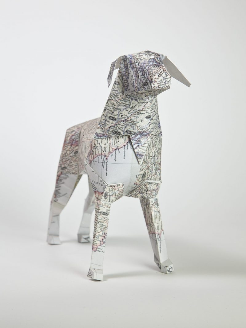 3D model of a paper dog with a detailed map design on its coat.