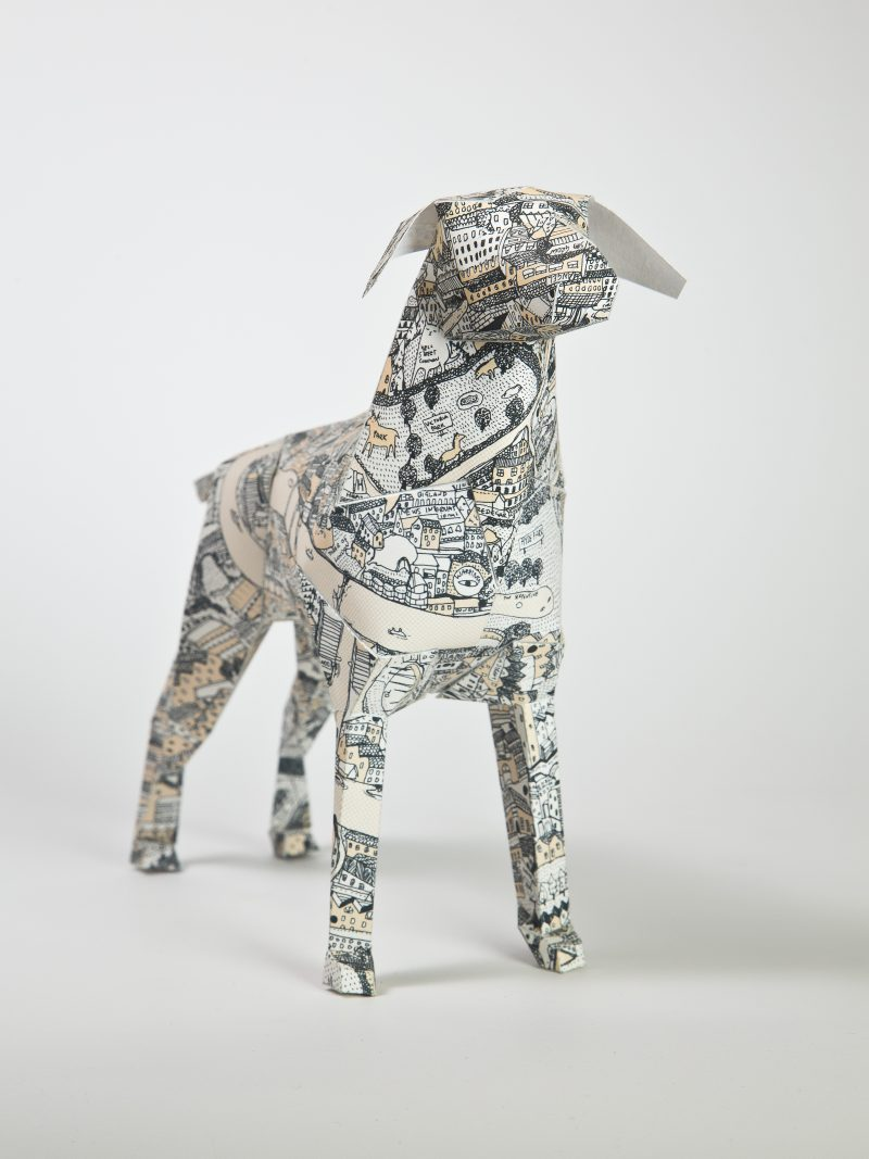 A paper dog sculpture from an exhibition