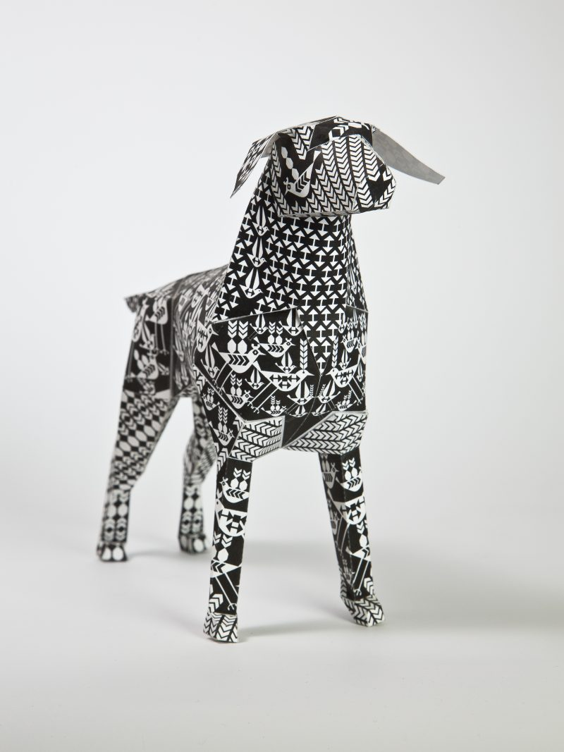 A paper dog design by artist Lesley BArnes. Black and white in design. Part of an exhibition by design studio Lazerian