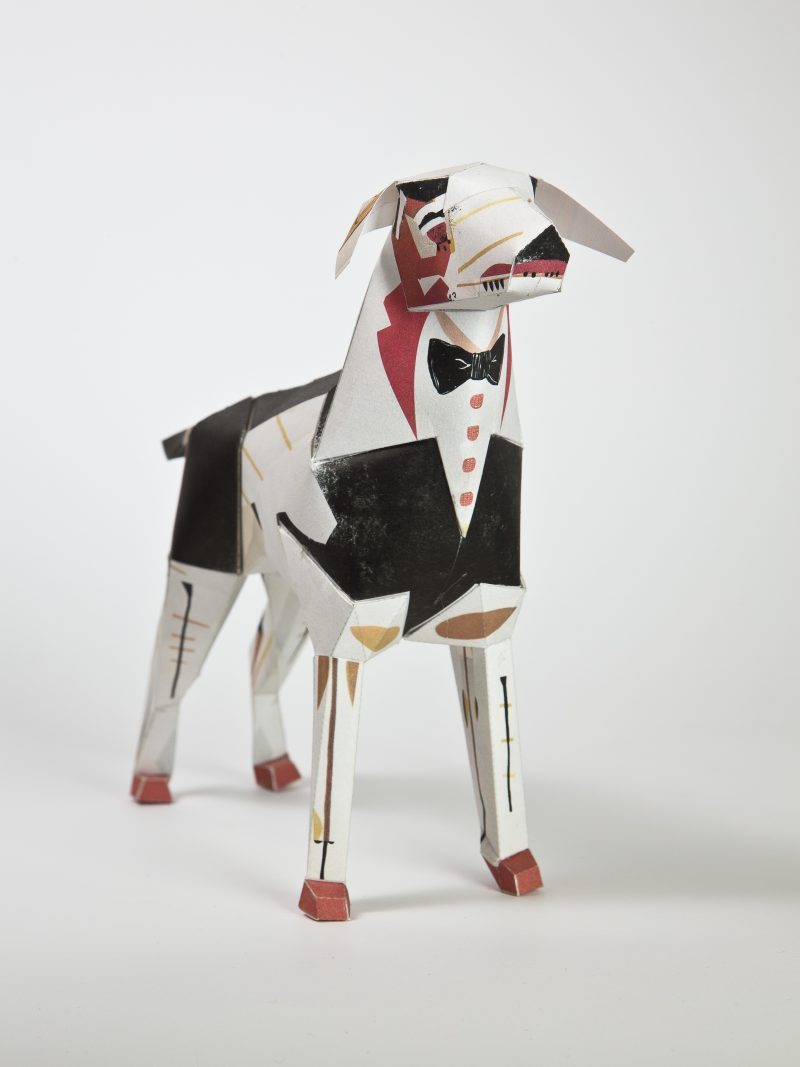 MMMMMain view of a paper dog model dressed as butler. Part of a design exhibition by Lazerian and the butler design is by Christos Kourtoglou