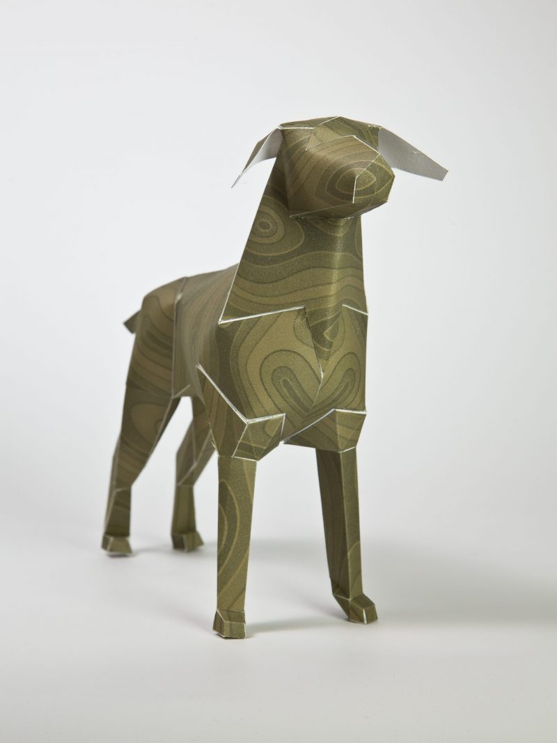 3D paper dog sculpture with a wood grain pattern