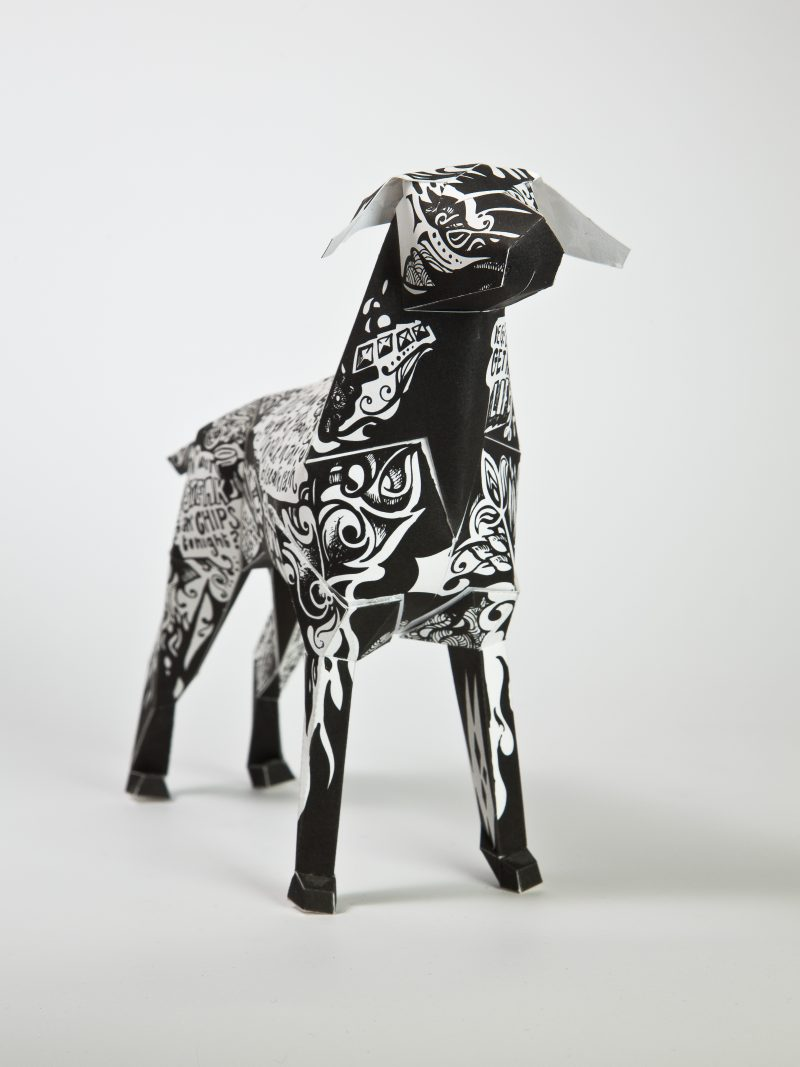 A 3D sculpture of a paper dog which is the mascot of leading designers and creators Lazerian. Part of an exhibition where different artist and designers were invited to customise the paper dog in their own unique designs. This dog was designed by popular artist Grande Dame. Her take on the design is a black and white 60's style pattern which has been drawn all over the dog.