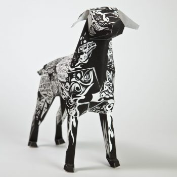 Paper dog model by design studio Lazerian. Designed with a black coat with white graffiti style writing on top
