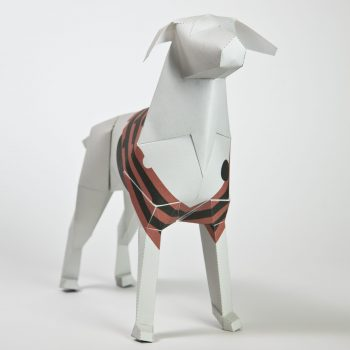 A 3D paper model of a dog. The dog has red and black stripes across its torso.