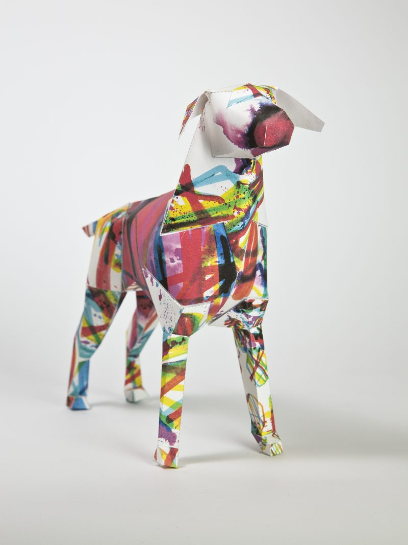 Dog strcuture made from paper into a 3D sculpture form- the mascot of leading design studio Lazerian. As part of an exhibition from Lazerian who invited artists and designers to customise the paper dg model in their own signature styles. This one is from internationally renowned artist and illustrator Kerry Roper.