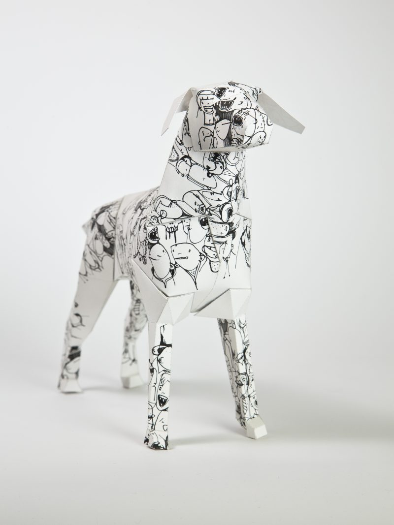 Main view of a black and white paper dog sculpture. Part of an exhibition by design studio Lazerian