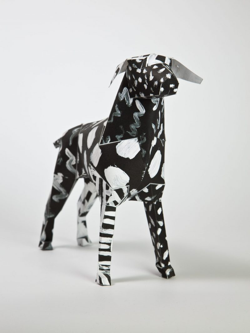 Paper dog model by design studio Lazerian. The pattern on the model is black with white paint strokes