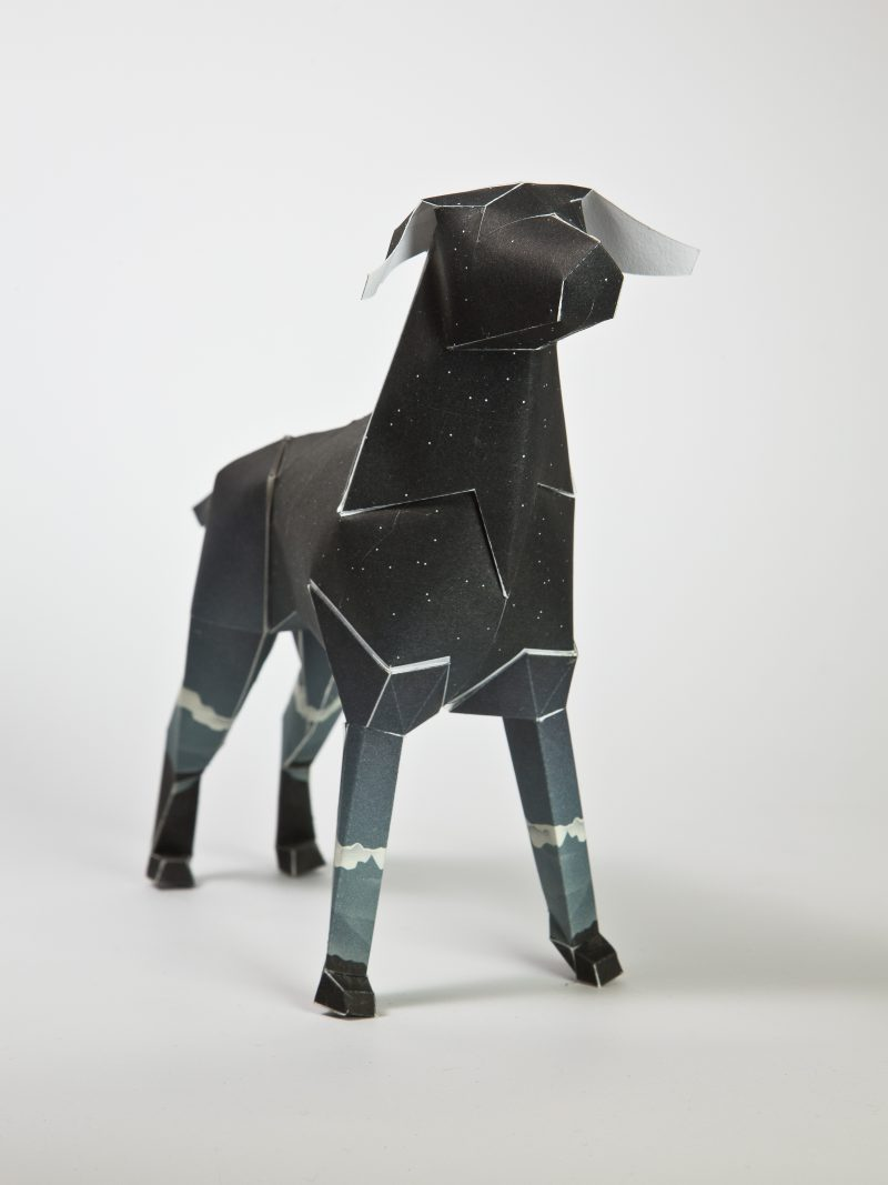 A dark coloured paper dog sculpture from artist Jack Hughes. From a project and exhibition by Lazerian featuring the companies mascot- Gerald the Lazerian dog in a 3D sculptural form. Designers and artists were invited to customise the dog in their own unique and signature styles.