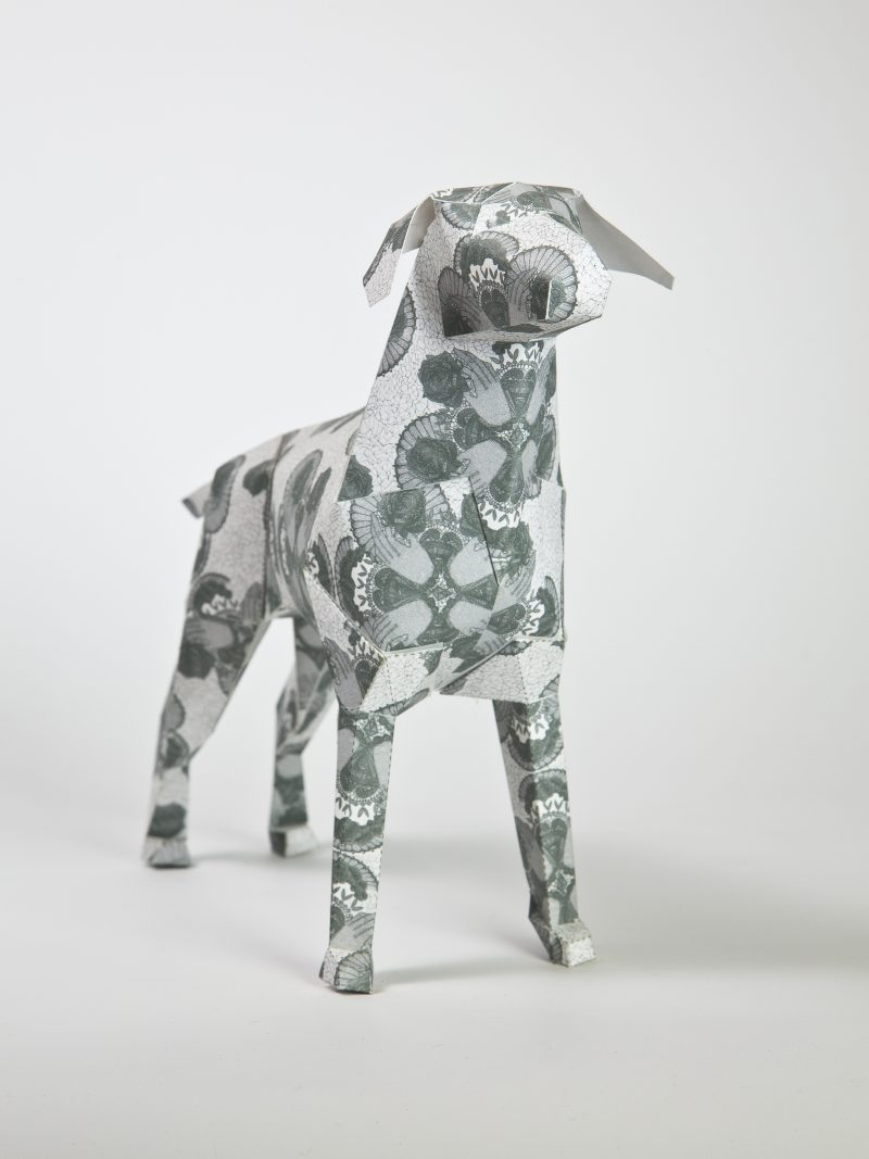 A paper dog sculpture from a international design exhibition by design leaders Lazerian. Different artist and designers were invited to showcase their talents on the body of the 3D paper model. This design is by Deborah Ballinger and is a simple lace effect that she hand drew onto the paper.